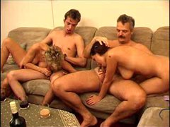 mature couple with young couple exchange