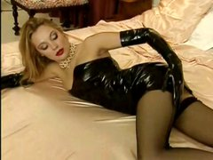 Blonde whore Laure Sainclair wears black latex and gets hammered
