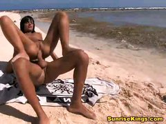 Black babe Angelika is naked and getting it hard on the beach