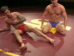 Horny studs wrestle with their oiled bodies