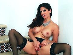 Glamour puss Sunny Leone looks awesome dressed up only in her sexy black lingerie and high heel shoes. watch and listen and she sits a step and talks dirty as she spreads her legs and inches her finger deep into her beautiful tight pussy.