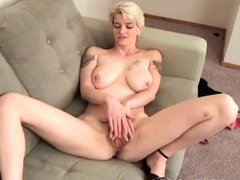 Tattooed busty blonde's masturbation solo