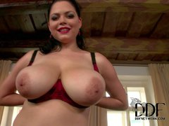 Shione Cooper is a curvy dark haired lady with big
