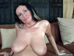 Mature temptress Pandora is proud of her big natural boobs