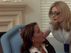 Bespectacled mature lady Nina Hartley is a hot lesbian lady