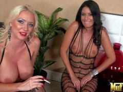 Molly Cavalli and Nikki Daniels are two sexy dressed lesbian
