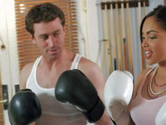 Dark haired exotic babe feels horny after boxing with handsome