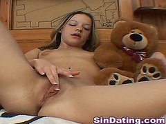Cute young teen babe plays with her best teddy friend