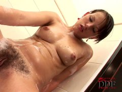 Ansie Rocher dildo fucks her hairy pussy in the bathroom.