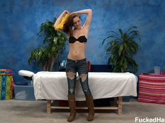Emme strips on camera in the massage room. She removes