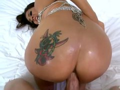 Delicious brunette Raylene with tattoo on her big wet ass