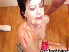 Petite MILF sucks cocks at bukkake party