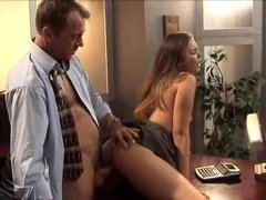 Young lady in a dress has sex at the office