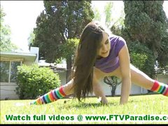 Mila sporty brunette teen with long hair and natural tits undressing and exercising outdoors