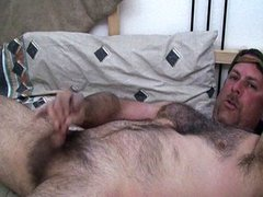 Hairy guy stroking dick for fun