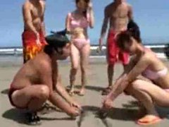 Japanese girls wrestling on the beach