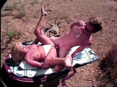 Blonde suck and fuck on a blanket in the dirt