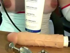 Pregnant fetish slut plays with her tits