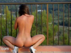 Killer ass undressing on the balcony