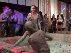 Mud wrestling with messy clothed cuties