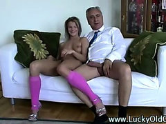 Old guy fingers and fucks younger blonde in pink stockings