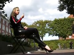 Blonde Ancilla Tillia in her latex outfit acting the tourist outside