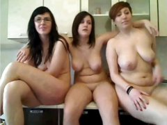 A bevy of 3 naked girls showing off on cam while in the kitchen