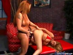 Two horny lesbians use a strapon to do some hot pussy banging