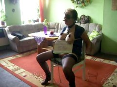 Busty girl gets tied to a chair and face fucked by captor