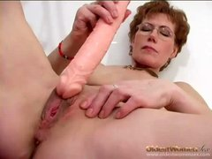 Dildo fucks her pussy in close up