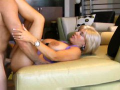 Housewife in a sexy dress boned in her house