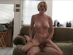 Busty blonde MILF shows her pussy and then gets cock in both ends